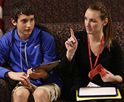 Photo of two students talking. Link to Life Stage Gift Planner Ages 22-44 Situations.