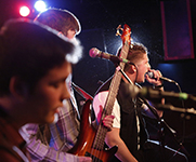 Photo of a band performing. Link to Tangible Personal Property.