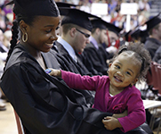 Photo of a graduate with her daughter. Link to Gifts from Retirement Plans.