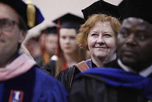 Photo of a woman at graduation. Link to Life Stage Gift Planner Ages 45-65 Situations.