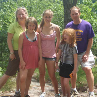 Photo of Amy Sibert and her family. Link to her story.